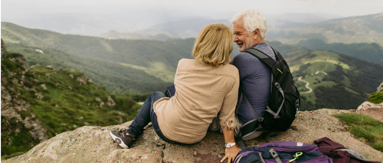 Older couple on top of a mountain