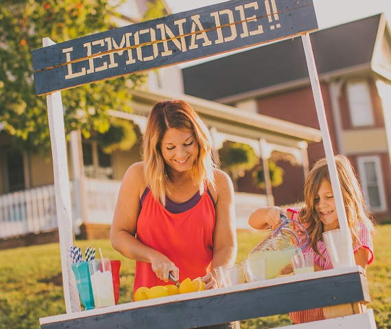 Woman and daughter working lemonade stand